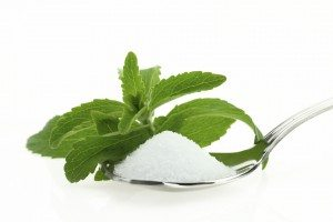 image of spoon with stevia and a stevia leaf